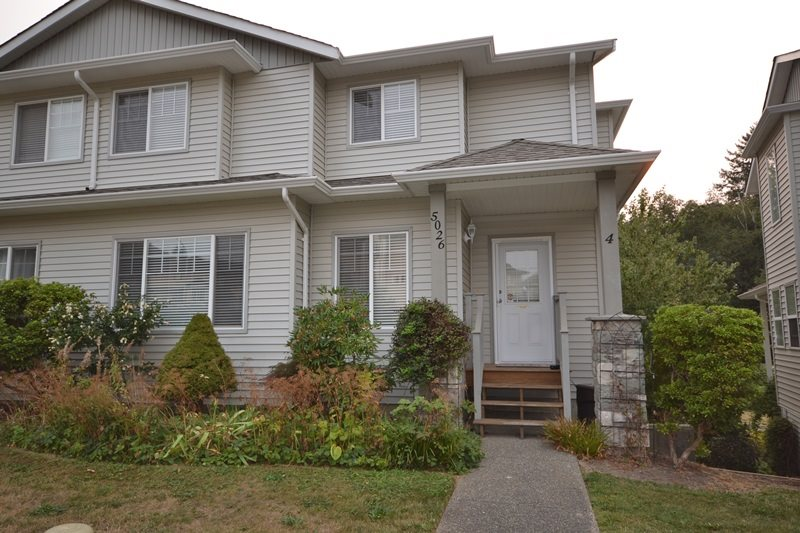 """Great Value in this 1/2 duplex backing onto greenbelt! Open floor plan with hardwood floors, ceiling fans, air conditioner, kitchen with an island, dining room opens to 8' x 20' private deck overlooking green space. 3 bedrooms up, large master bedroom w/walk-in closet and vintage claw-foot soaker tub in the ensuite. Approx. 500 sq ft unfinished basement, double car garage plus plenty of parking. Close to Promontory School & walking trails. 6 unit strata, pets allowed w/restrictions (1 dog, 1 cat under 18""""), no rentals. Southwest exposure. Quick possession possible!"""