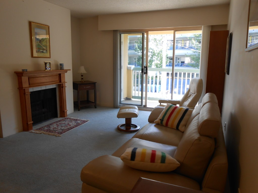 """Quiet quality corner unit on the 3rd floor of Gilford Court, West of Denman Street near Stanley Park. Walking distance to local shops, tennis courts, swimming pools, and 1 block to English Bay beach/seawall. Includes one secured underground parking spot, storage locker, fitness centre, sauna, and activity room (enjoy the book clubs and jigsaw puzzles) In suite laundry hookups available including venting, water, and electrical. One bedroom with custom built storage, upgraded kitchen and bathroom corian countertops, fridge, stove, garburator, dishwasher, gas fireplace, kitchen cork flooring, Godfrey Hirst natural wool carpets. Open House 1-3pm on Saturday September 23 and 1-3pm on Sunday September 24th, Submit offers starting Monday September 25. For more information about this listing and more photos, please click the grey colored """"Go To Listing"""" button. If you are on the REALTOR app, please click the """"Multimedia"""" button."""