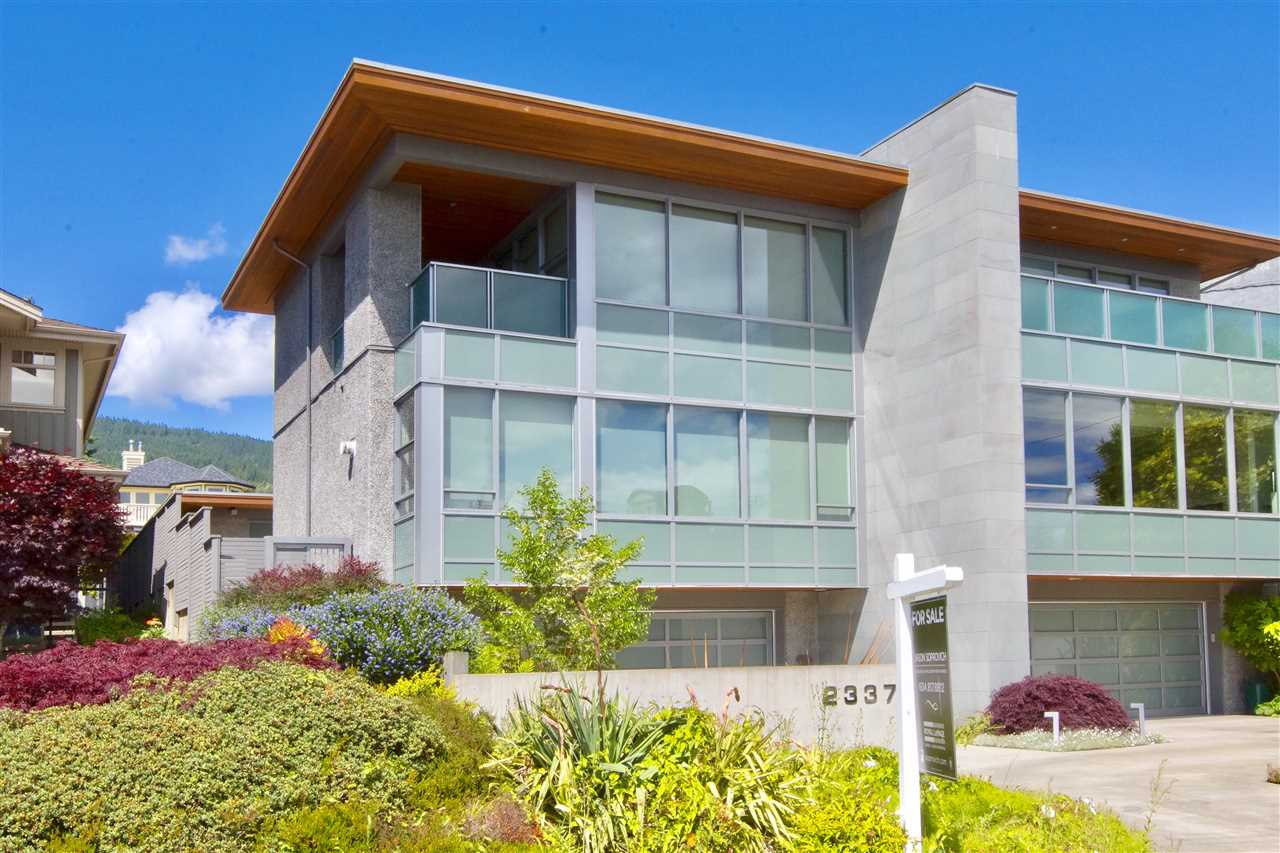 One of the most distinctive Duplex residences located steps to Dundarave Village & Seawall! This Contemporary res offers a convenient & low maintenance lifestyle w/3,439 sf on 3-levels featuring a bright open floorplan w/large commercial grade windows & smashing ocean views. Generous living areas w/white-oak h/w & limestone flooring, stone fireplace, built-in TV/internet/sound system, magnificent kitchen w/top-of-the-line appliances, luxurious main floor Master bdrm & spa-like ensuite ? all opening to intimate courtyards & entertainment areas, gardens & separate detached office & gym flex rooms. Down offers a media room, wine room, 4th bathroom, mudrm & extra wide 2-car garage w/keyless entry. Walking distance to Dundarave Village, Seawall & Pier make this a one-of-a-kind opportunity.
