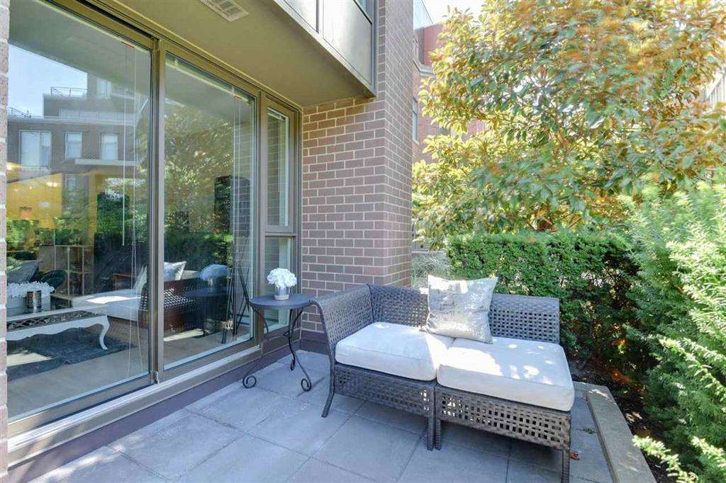 This beautifully set townhome has a lush, garden outlook, away from the busy streets, and offers an open floor plan w/ plenty of room for entertaining on the main level & a large private patio.The upper level is complete with 2 large bedrooms w/ensuites & bright den/flex room perfectly fit for an office or nursery. High end finishings incl. stainless appliances, granite counters, soft-close cabinetry, laminate flooring & spa-like bathrooms. Generous parking space & storage locker. Excellent ammenities incl. gym, yoga room, party room, concierge service & park-like green space all around it. Fantastic location STEPS TO SEAWALL & Canada Line & a quick walk to Olympic Village.
