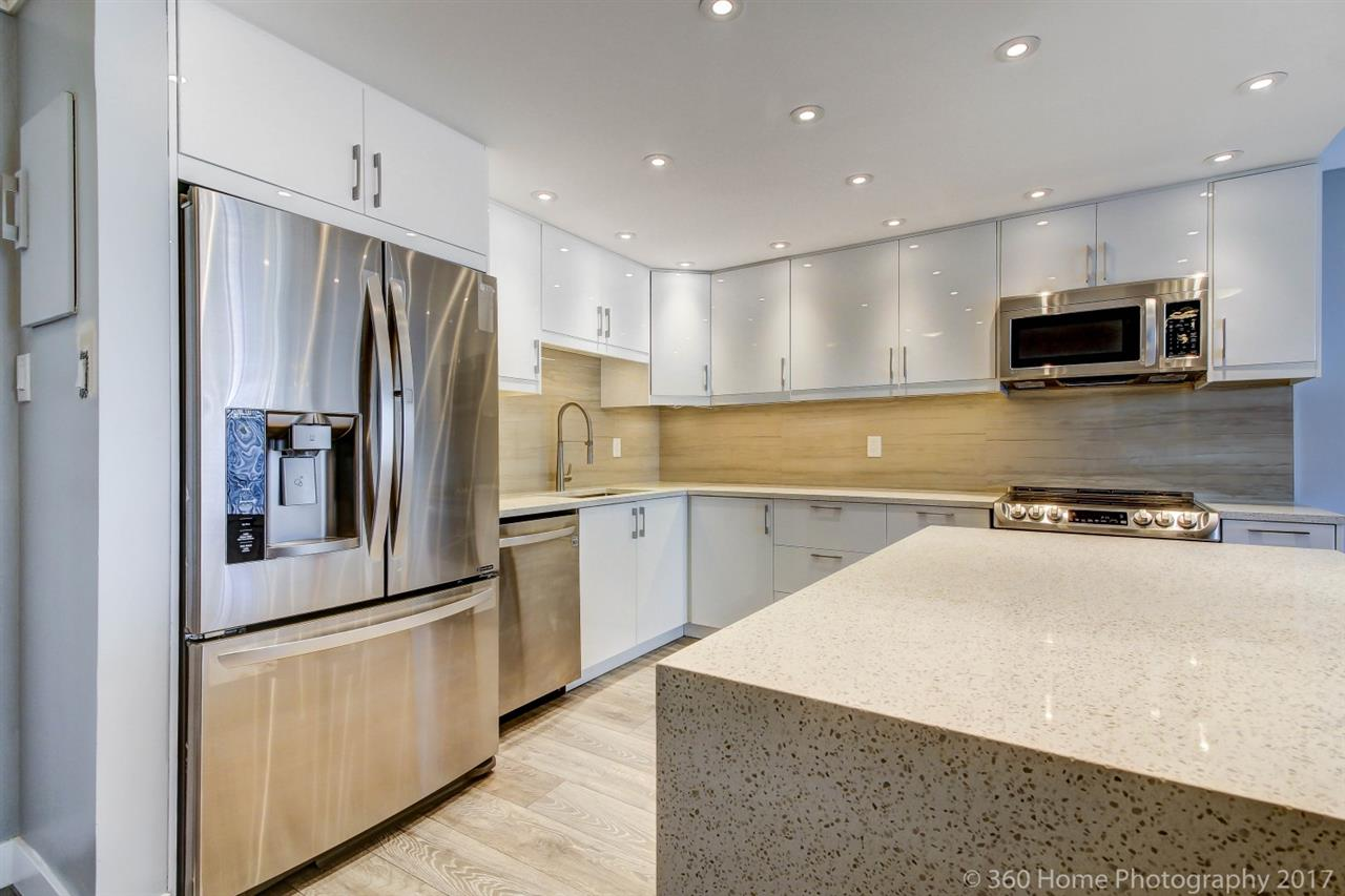 Showstopper at the Heritage! Fully renovated top to bottom large 2 bedroom/1 bath condo with great views. You will love this bright condo in concrete highrise with oversized windows, massive master bedroom and fully renovated state of the art kitchen with quartz counters, s/s appliances, backsplash and new cabinetry. Totally remodeled bath with new tiles and vanity. Freshly painted with new doors and light fixtures. Large 150 sq ft covered patio overlooking peaceful courtyard with glimpse of Fraser River.  Fantastic location uptown with shops, restaurant, skytrain nearby. Amenities: workshop, sauna, exercise room, swirl pool and lots of visitor parking.   Open House Sunday, October 15th 2pm-4pm