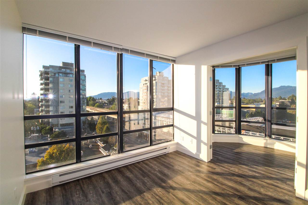 Incredible views from this 2 bedroom and den corner unit home. This home has had recent updates that include flooring through out, baseboards, fresh paint, light fixtures, stainless steel appliances. It is ready for you to move in. Steps to the skytrain, for quick commuting or heading out on the town. The floor plan allows for both living and dining areas and the den would be an amazing home office. The storage locker is large (aprox. 6 x 6) and it comes with one parking.