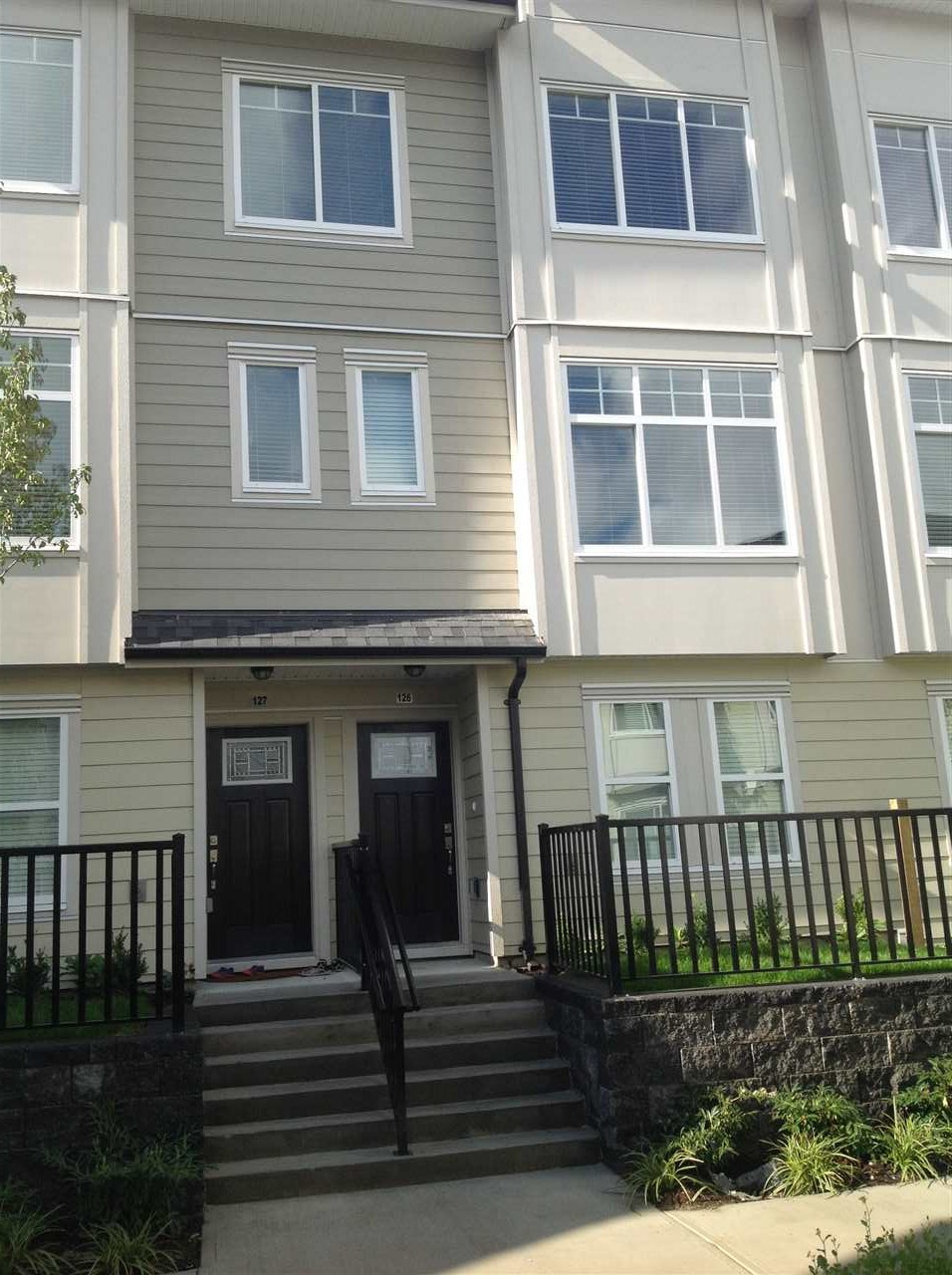 """Brand New - GST paid - townhouse 3 bedroom plus den on main 2.5 washroom- single garage plus carport expensive windows/quartz counter/crown molding and 9"""" ceiling. Quick access to HWY 10 and close to shopping/school/transit and park-1500 square feet/low strata fees if $173.00. OPEN HOUSE SAT 0CTOBER 21 FROM 2-4 ."""