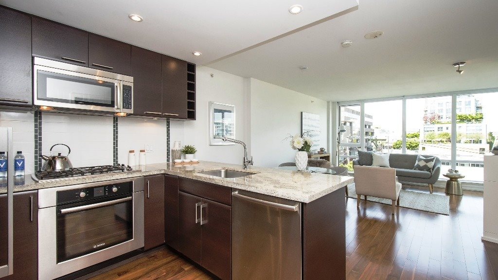 Welcome home to chic and trendy South Granville at Musee! This bright and open one bedroom plus den home features engineered hardwood floors, insuite laundry and expansive windows throughout, bringing in lots of natural light. Gourmet kitchen with granite counters, gas range, and Bosch and Fisher & Paykel stainless steel appliances. Master bedroom with cheater ensuite and balcony looking out on to a great view of the mountains. Amenities include exercise centre, playground and bike room. This stylish concrete building is ideally located, only steps to trendy boutiques, restaurants, Granville Island and UBC bus route. Don't miss this one!