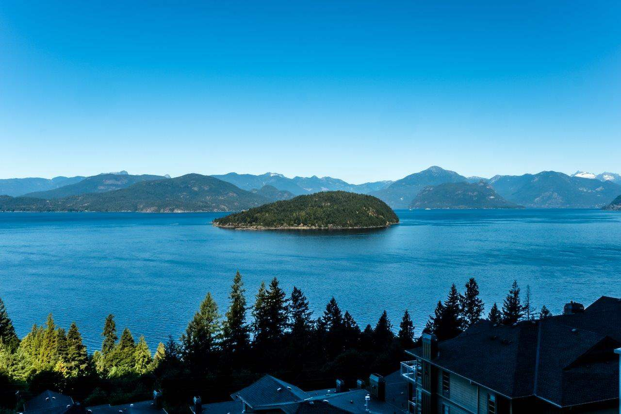 """Only one week left to purchase this stunning turn-key property. Spectacular breathtaking close-in panoramic views of Howe Sound waterscapes and snowy mountains beyond. This is the best lot in Seascapes. Most quiet portion of Seascape Drive with minimal road noise. Level driveway and easy care lot. Walk inside to the """"most desired"""" 2600 sq. ft. """"Bellevue"""" floorplan, not too big, not too small. Walk-in garage with master suite on the main. Recreation/media room and guest bedrooms down. Lots of storage. Extensive custom upgrades including gourmet kitchen and delightful hardwoods and designer paint colours. Lovely deck for lounging and taking in those nightly sunsets. Electric awning for summer time cooling. More than enough storage. Fantastic turn-key residence...just move in. Hurry, this is the best that """"Seascapes"""" has to offer! ...only $1.698 mil."""
