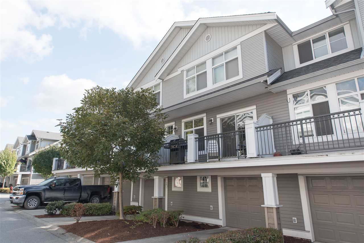 PRIME UNIT IN NATURE'S LANDING - STREET FRONTAGE YET TREED FOR PRIVACY! This beautiful 3 bedroom townhome has many rare sought after features including: upgraded closet organizers, granite counter tops, powered kitchen island, front load washer & dryer, gas range, gas fireplace, large 19' x 6' deck & 3rd open parking space (great for oversized vehicles). BONUS! Smarthome features: Bluetooth enabled access + built-in Bluetooth speakers in garage. Worried about being tight for space in a tandem townhome? You won't be feeling cramped in this 1437 Sq Ft home with high ceilings & plenty of storage! Walking distance to all levels of Schools, Parking, Shopping, Daycare & Montessori. CALL TODAY TO VIEW!