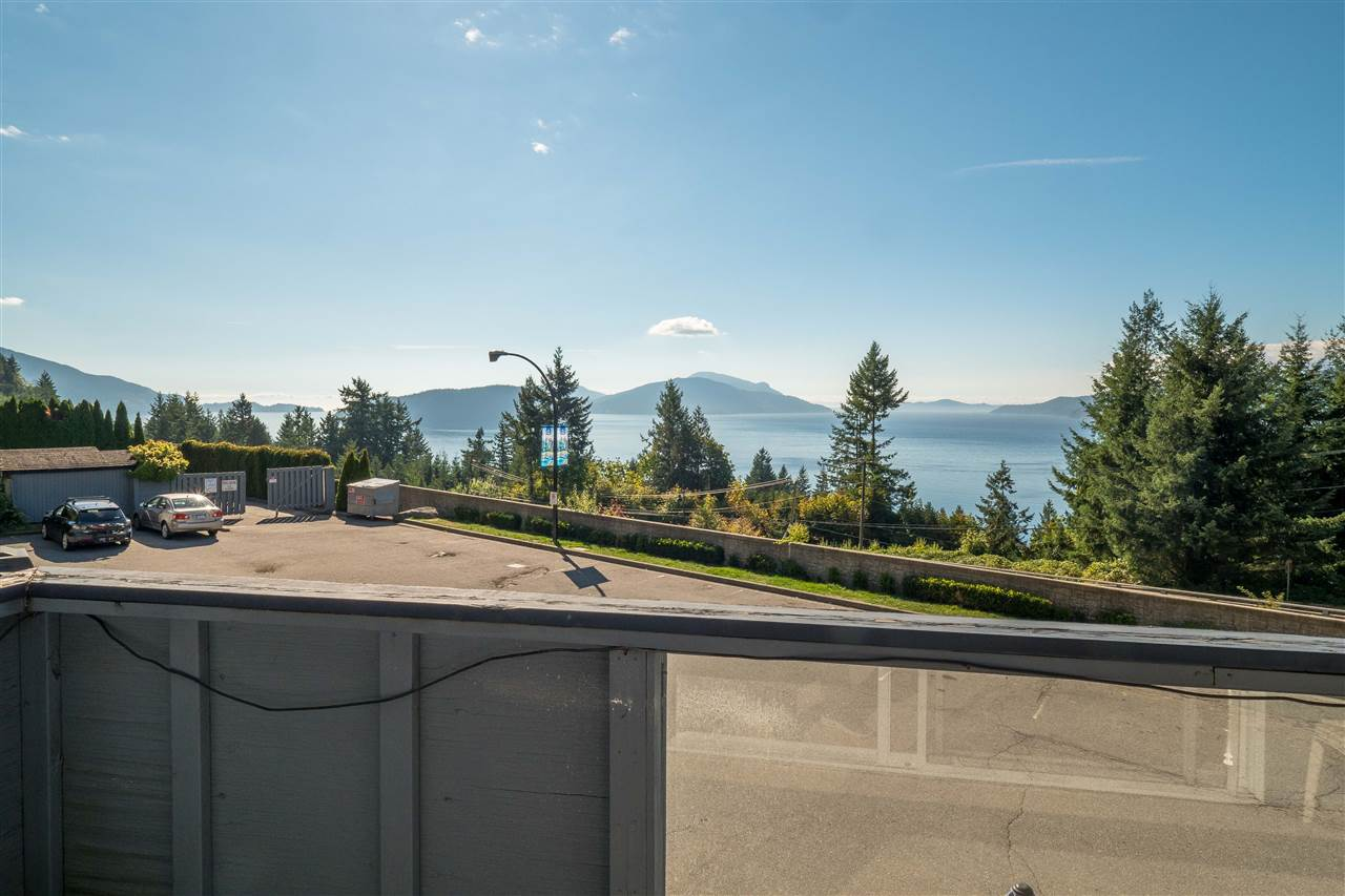 Huge oceanviews from this rarely available condo home. Offering 1043 sq feet of living space, with 2 bedrooms + large flex room. Custom paint & baseboards, new flooring throughout. One block from the bus , easy walk to the beach. Over 300 sq feet of view deck, great for entertaining or simply enjoying the stunning views to Howe Sound. Easy to show!