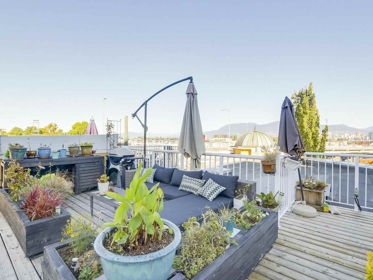 Bright top floor unit with one of only six roof top decks, decks are Limited Common Property for each strata lot.  Excellent location; steps from transit or walk to downtown, Granville Island, West 4th and South Granville shopping.  Unit features granite countertops, stainless steel appliances and upgraded fireplace.  Enjoy city and mountain views from bedroom and living room. Walk score 97. Open Sat/Sun 1-4 pm Oct 14/15