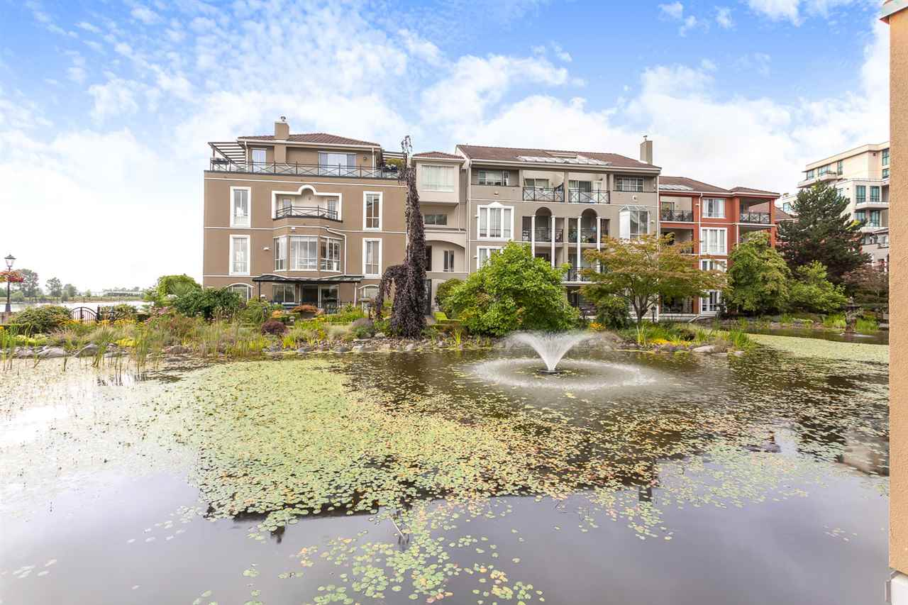 Stunning renovated 2 bdrm/ 2 bthrm unit nestled amongst the lagoons w/ a view of the beautifully landscaped gardens & partial Fraser River view. Reno'd kitchen w/ white cabinets, counters, s/s appliances, private eating area, tiled flooring. Both bthrms are unique w/ new counters, tiled walk-in shower & mosaic tiled flooring absolutely beautiful. This unit features private covered balcony, laminate flooring, 9'ft ceilings, new washer/dryer, designer paint/wallpaper, new gas fireplace & crown molding. Lovely light in this unit w/ floor to ceiling windows plus access to balcony off master/LR & a private entrance. Close to Boardwalk, Quay, transit, shopping & restaurants. Great piece of mind-rainscreened building! 2 pets ok. 1 SECURE parking stall/1 locker
