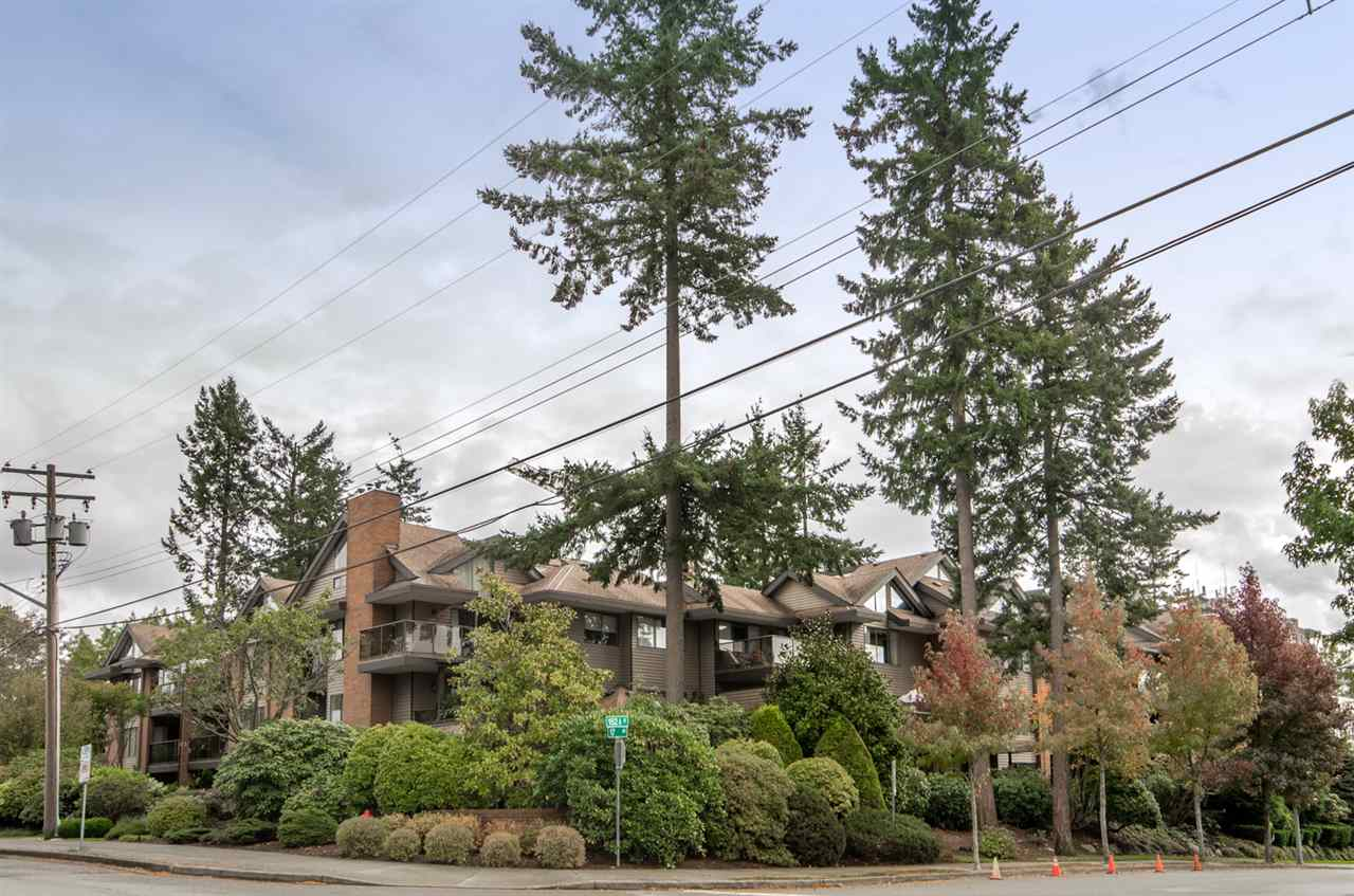 Wonderful WEST facing 1453 square foot condo just outside of White Rock! WALK to Semiahmoo mall, parks& all amenities. QUIET, solid building &well run. This unit feels like a detached home with 5 piece master &3 piece second bathroom that are original and well cared for. Huge Master with walk in/thru closet. Large laundry room with extra storage. Carpet not new but in good shape. Kitchen updated with stainless steel appliances and Maple Kitchen cabinets with pantry. Two HUGE patio/decks, one open (with Western explosure) and one covered (with North West exposure) for your outdoor enjoyment. Well equipped WORKSHOP in the building as well as convenient parking stall, Seller also rents second parking spot for $20/month ( and STORAGE locker)