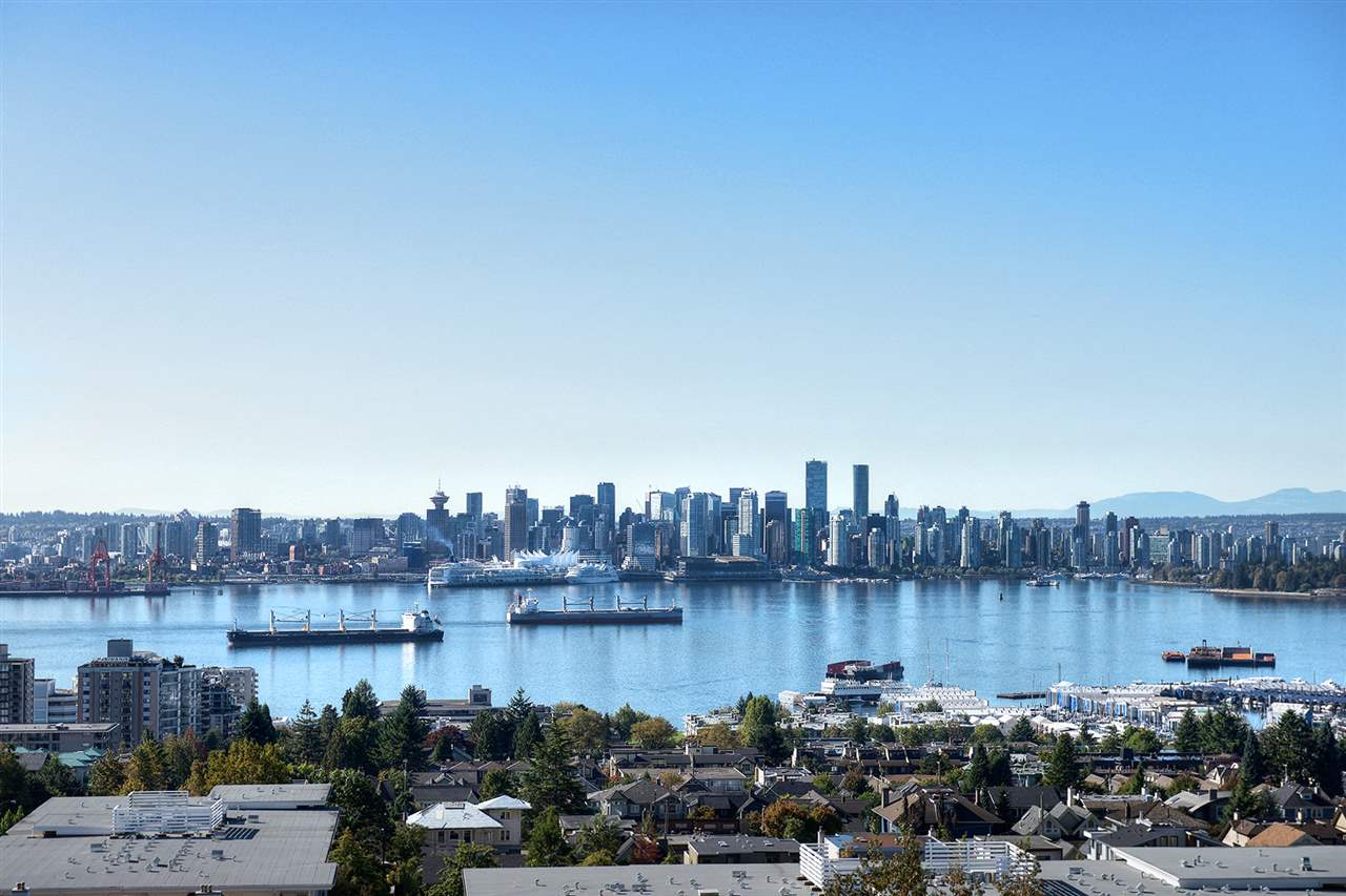 """Enjoy amazing, panoramic views of the ocean, Lions Gate Bridge, city and the North Shore mountains from every room in this beautiful home. Smartly designed with high-end finishings including rich, dark wood floors, stone counter tops, S/S appliances, full size washer & dryer...  The efficient floor plan has 2 bedrooms, 2 baths plus an alcove for an office. """"Vista Place"""" is immaculately maintained and offers: resident manager, quest suite, exercise room, social room and visitor parking. LEED certified. The quality of this building is evident and the location is very convenient. Open house Sunday Oct 15th 2:00 - 4:00pm"""