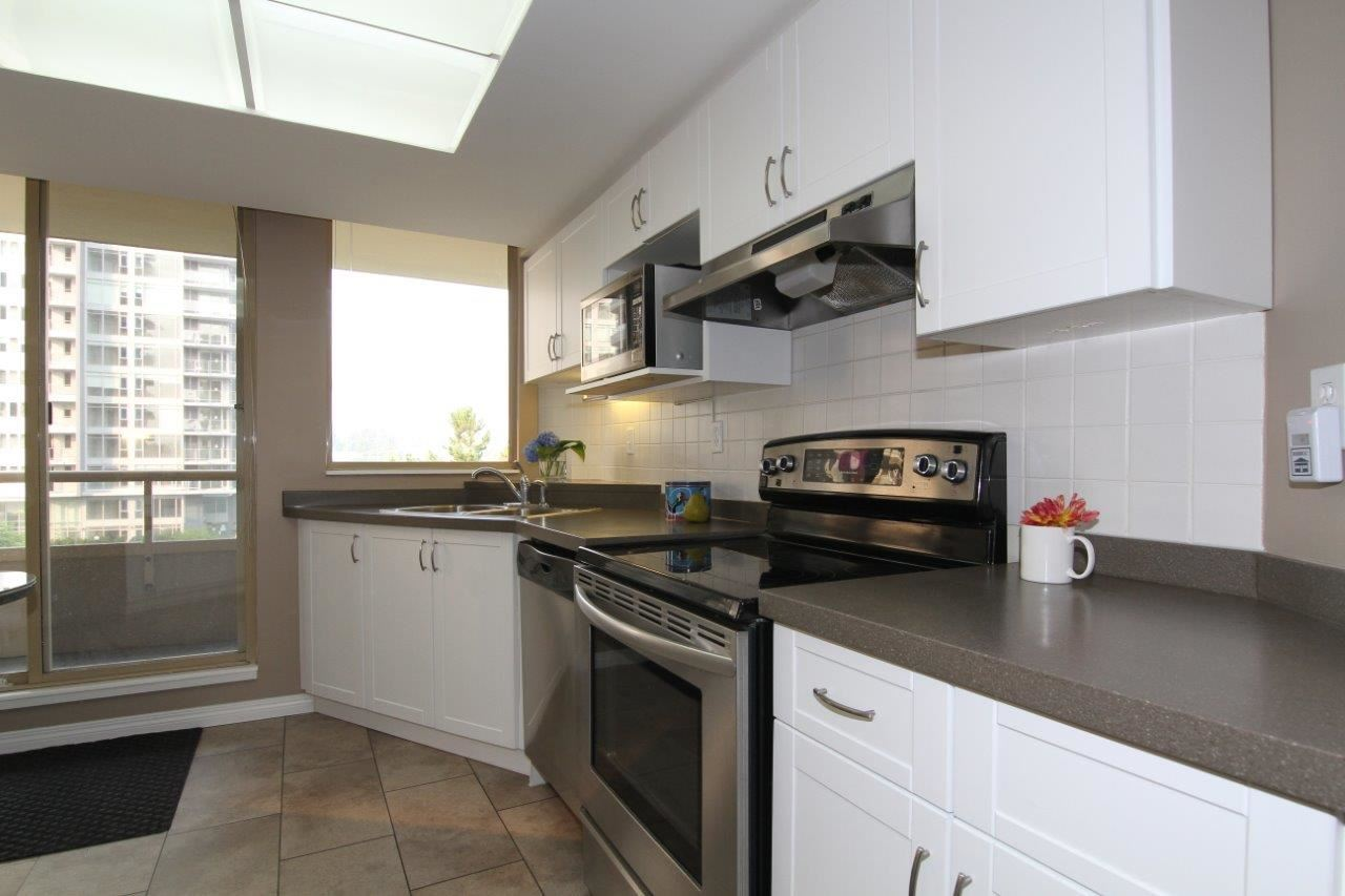 Just steps away from the Burquitlam Skytrain station, this 2 bedroom, 2 bathroom, 1196 sq.ft. home features a spacious and functional floor plan.  This corner unit offers plenty of outdoor space with 2 balconies.  The recently renovated kitchen has stainless steel appliances, white cabinets and corain counters.  The master bedroom has new floors and 3 closets.  Both bathrooms have also been renovated and new blinds have been installed. The unit features a huge storage area inside and an additional storage locker underground. Great building with both indoor/outdoor pools, sauna and hot tub. Prime location just 1 block away from transit, close to SFU, shopping and easy access to Hwy 1. OPEN HOUSE SATURDAY OCT 14 2-4PM.