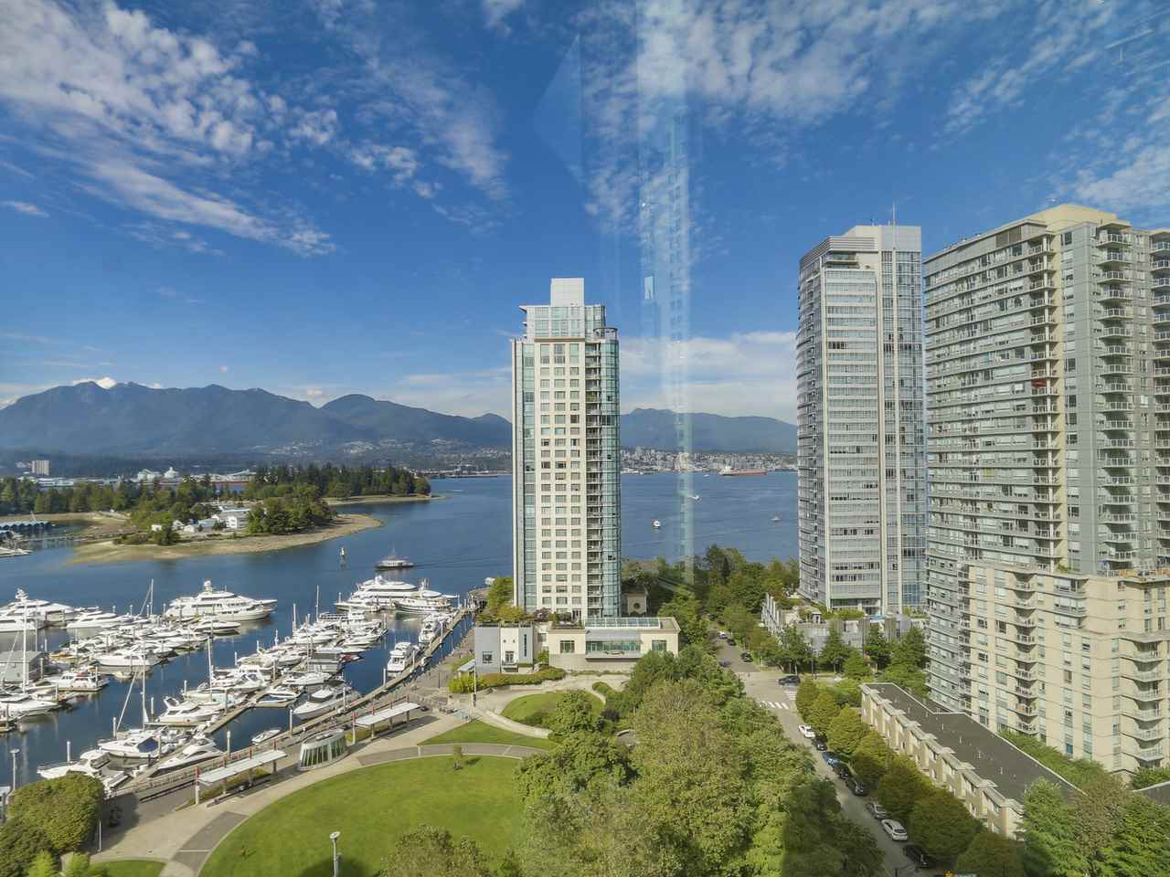 Oceanfront living at its finest! Sweeping FLOOR-TO-CEILING WINDOWS provide panoramic vistas of Burrard Inlet, the North Shore Mountains, and Stanley Park. Unit tastefully upgraded with bamboo flooring, stainless steel appliances, quartz countertops, mosaic glass backsplash in kitchen and marble tiling throughout spa-inspired bathroom. HIGHLY EFFICIENT FLOOR PLAN with absolutely no wasted space and ample natural light. Meticulous strata with MASSIVE CONTINGENCY RESERVE FUND and FIRST RATE AMENITIES, including theatre room, billiards table, party room, exercise centre, swimming pool/hot tub, rooftop patio, and expansive private gardens. On-site caretaker and ample visitor parking. Pets & rentals welcome!