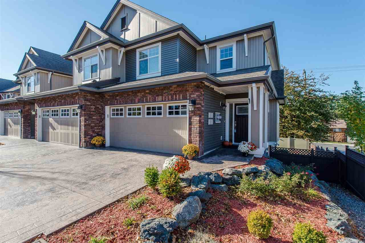 Beautiful END UNIT in Kingsbury Place- right in the heart of SARDIS. This fully finished 2225 sq ft. 2 storey w/ WALK OUT bsmt has a LARGE fully fenced yard, dbl garage, FULL driveway, and CENTRAL A/C. Stunning modern kitchen w/ granite counters, tile backsplash, island w/ eating bar, garburator, loads of storage, and all S/S appliances. 3 bdrms up including a 13'4 x 15 master suite w/ a huge w/i closet & full ensuite bathroom. The basement incorporates another large bedroom, media area w/ roughed in wiring and electric fireplace, storage areas,& access to your PRIVATE FENCED supersized backyard. FANTASTIC location in walking distance to shops, parks, restaurants, and all levels of schools. LOW strata fees, pets & rentals allowed!