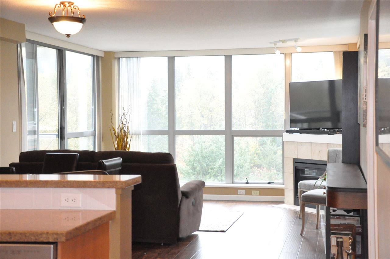 This 2 bed, 2 bath corner unit is in immaculate condition with floor to ceiling windows, great layout with bedrooms on opposite sides of the suite. New Hardwood floors, New S/S appliances, freshly painter through out, Beautiful granite counter tops in kitchen. With the Evergreen line a 5 min walk away. You could have the best of both worlds, work in Vancouver and live in Port Moody, no need for a car with everything so close, grocery stores, liquor store, library, meat and fish shop, great walking trails around the inlet, restaurants and pub, and much more. Comes with 1 parking stall and 1 locker