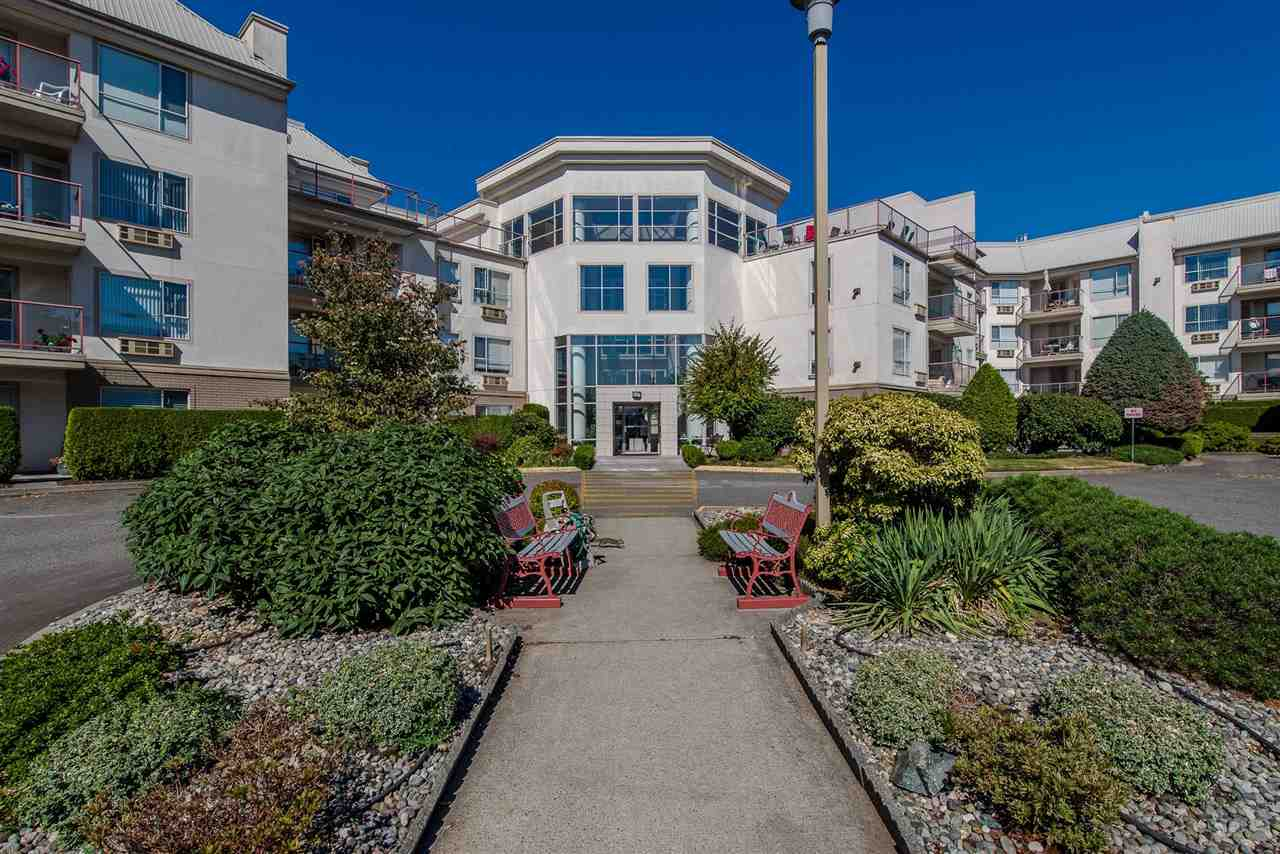 LARGE UNIT - OVER 1400 sq. ft.  THE BEAUTIFUL WEDGEWOOD - The best of its kind for those 40+. This gated complex is on of a kind in the area. 1st floor corner unit, many large windows and a nice patio facing N/E for sitting out and enjoying the birds & fresh air. Very well kept with some updates. 2 secured underground parking spaces. The entrance is stunning with a glass domed 40ft Atrium featuring a waterfall, this building is a State of the Art. Amenities include billiards room, games room, 2 elevators, workshop,  storage and 2 guest suites.Walking distance to Church, Bank, Coffee shop, transit & other. No pets, no smoking or rentals.