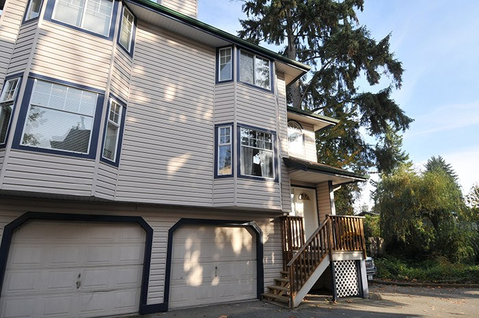 Looking for a great townhome? You can stop your search today! Beautiful spacious Port Coquitlam home located in very central part of town. Close to schools and transit! Close to all shops and amenities! Super END UNIT! Bright livingroom with bay window and inviting fireplace, formal diningroom, kitchen boasts oodles of cupboards and space perfect for the cook! Enjoy relaxing on your deck with fenced backyard that backs rare greenbelt, tranquility at its finest! Upstairs you'll find 3 good sized beds and laundry. 3 Baths. Down a big Rec room for the kids or another family room. 2 parking spaces. New carpets, fresh paint, newer appliances what are you waiting for!