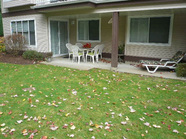 """Great 2 bedroom townhouse located in nice family oriented complex """"The Alderglen"""". Lower floor, corner unit, no stairs. Open floor plan. Laundry room with stacking washer & dryer off open kitchen. Large private covered patio with southern exposure and backing onto spacious grass area. No age restrictions. 1 small dog or 1 cat allowed."""