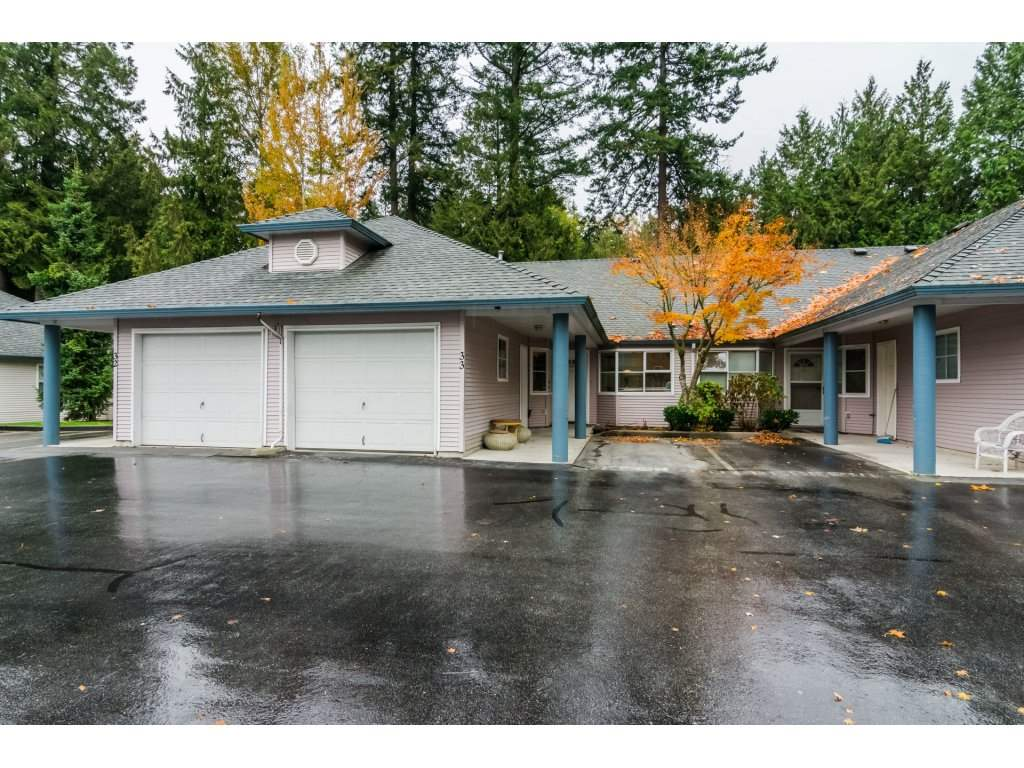 ASHLEY GROVE! BE SURE THIS HOME IS ON YOUR LIST!! This 2 Bedroom & a den Rancher Townhouse is a MUST SEE! Incredible Location at the Back of the complex - backing onto Greenbelt! Upgraded with New Laminate Floors! New Lino! New Doors! F reshly painted! Open Plan Kitchen - open to both the Breakfast Nook (and Den) and also the Dining Room! Great for Entertaining! Spacious Living/Dining Combination! Walk-out from Living Room to the Incredible Yard! WOW! Spacious Master with 3pce Ensuite! Plus good sized 2nd Bedroom too! Main bath has a walk-in Tub! Single Garage plus 1 parking space in front of unit! Complex has newer roofs! Best price & location in complex!! BE FAST!!