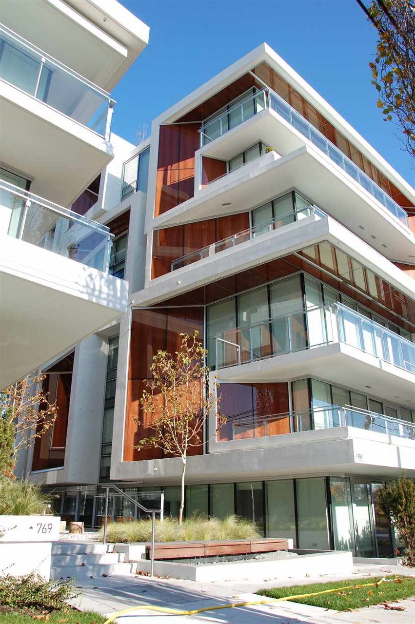 Still new 2 bedroom, 2 bathroom ground floor corner unit in Aperture, a mid-century modernist building with westcoast flare. Super convenient living, right across from Oakrdige Mall, 5 minutes from Oakridge Skytrain Station, with easy access to airport, downtown & UBC. The floor to ceiling windows allow abundance of light infusion. Open plan kitchen living & dining area with the living area overlooking the Asian-inspired landscape featuring wood, bamboo, river rocks & running water. The modern kitchen is equipped with Miele appliances & quartz countertop. Two bathrooms feature stylish marble inspired tiling & Grohe faucets. A rooftop garden with play area & BBQ completes your entertaining needs.