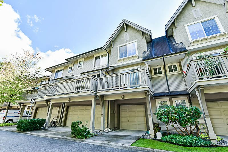 "Desirable ""Ashcombe"", in a family oriented neighbourhood! Spacious 2 level townhome features 2 large bedroom, 2.5 baths and a tandem garage. 9' ceilings on the main floor, open floor plan living, dining areas, kitchen & powder room. Central location, next to Robert Burnaby Park, SFU, transit & shopping. Walking distance to Armstrong Elementary & Cariboo Hill Secondary (French Immersion). Car wash station in complex. Low $260.00 monthly strata fee. 2 pets allowed. Open Sun, Nov 19, 1-3pm."