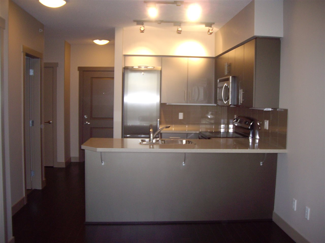 Here is your opportunity! South facing large 1 bedroom unit with den. Includes 1 parking stall and storage locker. Currently tenanted on month to month agreement. This unit is steps away from restaurants, banking, schools and transit. For your convenience Nesters Market is located within the same building on the main level! This is a great unit to live in or rent out as an investment! The unit has it all: quartz countertops, garden patio, too many features to list! Please note that unit is currently furnished with tenant belongings. Fridge has been replaced and is different from fridge shown in pictures.  First Showing on Sunday, November 12, 2017.
