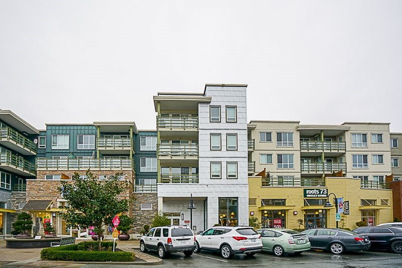Sought after location in South Surrey, close to shopping, restaurants. Boasts laminate flooring in living/dining room, cozy fireplace, entertainment size balcony 29'x10 plus covered balcony 10' x 5 for summer BBQ. Steps to shops, restaurants, shopping, fitness club