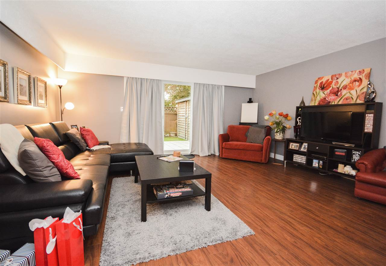GORGEOUS RENOVATED 1,152 sq.ft. 3 bedroom, 2 bath townhouse on a private location backing on to green space! Some of the updates include: beautiful new kitchen with new appliances, new flooring, slate feature wall, paint, doors & baths, windows, roof, hot water tank. Private playground, basketball court and green space all within the development. Your own patio garden with storage shed and barbecue area. Low maintenance fees and pet friendly strata (no restrictions). Well maintained Oasis complex! Close to shops, schools, transit & recreation! Convenient location for busy people! Rarely available. OPEN SUNDAY 2-4