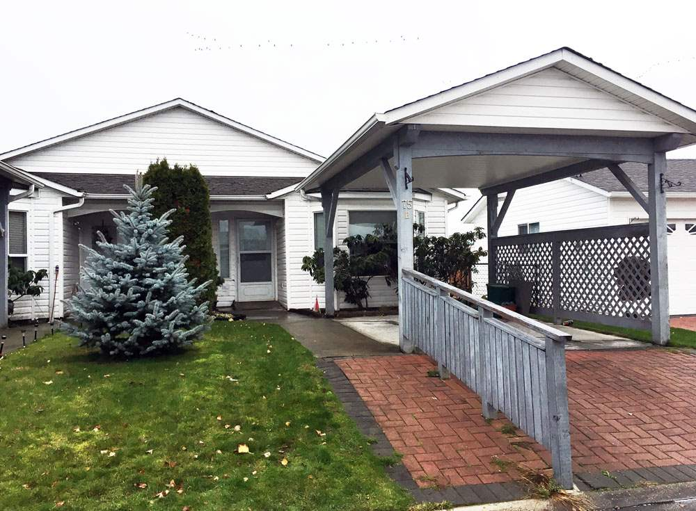 Have your own little yard and home for the price of a condo! These 1/2 duplexes don't come up too often. Monthly lease fee is very reasonable. Dogs ok in this park. Security gates closes at 5:00. Active clubhouse with lovely gardens and secure walking inside the park. 2 bedrooms, 1 bath with in-suite laundry. Vaulted ceiling in living room increases the feel of the space. Wheelchair friendly. Will need a little paint but ready for quick possession. Super cozy. Backs onto farmer's field. Quick shopping and freeway access. Buyers thinking about mobile homes need to consider this property!