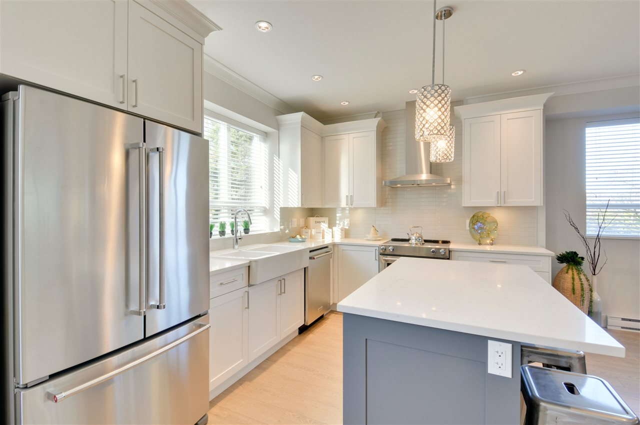 END UNIT: Brookside Walk - a brand new high-end townhome, completed & ready to move-in w/ 3 beds + den, 3 baths all w/ quartz countertops, double side-by-side garage, fenced yard, extra-large balcony & mini split heat pump w/ AC. Main floor features a gourmet kitchen w/ 3cm quartz countertops, kitchen island, shaker style soft close cabinetry, SS KitchenAid appliances, chimney style hood fan, durable wood laminate flooring, crown moulding, spacious dining rm & a TV feature wall w/ a Napoleon fireplace in the living rm. Tile floor & base in baths & laundry upstairs. Frameless 10mm thick ensuite shower door & tile surround. Automatic lawn & garden irrigation. So many great features incl. A complex of only 5 homes located on permanent parkland greenspace. OPEN HOUSE Mar 17-18 Sat & Sun 2-4pm