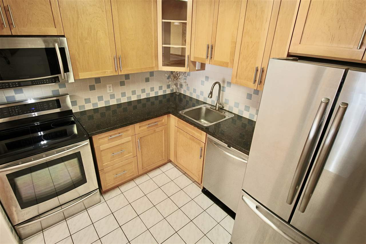 2 spacious bedrooms 1 bath 1,071 sqft in a well-kept quiet building with low maintenance fee $180/month. Major updates. Newer kitchen with granite counter tops and s/s appliances. Newer bathroom with granite counter tops and new tiles. New laminate floors. New balcony, new double glassed windows and sliding doors. Huge in suite laundry with newer washer and dryer and lots of in suite storage. One parking and one storage locker plus bikes room. Area of new development projects. 3 min walk to Skytrain station. 5 min walk to Port Moody elementary and middle schools. 10 min walk to Rocky Point Park. Close to major shopping centers, restaurants, modern recreation facilities, parks and lakes. Family paradise.
