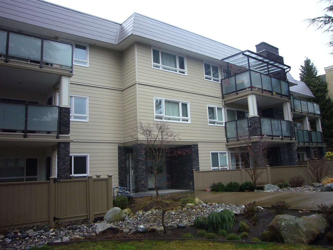 """Fully rainscreened, just 3 years ago. Exterior fully done (roof, siding, windows, decks, doors). Unit is clean but mostly original, awaiting your updating ideas.  Features a wood burning fireplace, oversize covered deck, 2 pets (either 2 cats or 1 cat plus 1 dog /  under 15"""" at shoulder ) are allowed in this 55+ building. A 5x7 locker and 1 parking stall (#1).  Strata fee of $393 includes your heat and hot water. No rentals here, in this no smoking building.... Easy access for showings, and quick possession ok.  Just 2 blocks to the mall."""