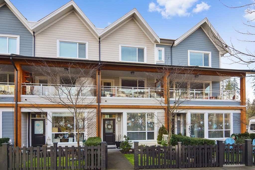 Sought after LIVE/WORK townhome in BEDFORD LANDING. Unique opportunity ! Walk up storefront entry with store window. Ideal for many in home business uses or can be office or 3rd bdrm. Great room living upstairs features space to entertain with beautiful kitchen, a covered north deck & sunny south deck. The upper floor offers 2 bedrooms with A/C , 2 full bathrooms. Peekaboo RIVERVIEW from master bdrm. Single attatched garage & carport with direct access to home. Wonderful location in Vibrant Fort Langley. All shops, restaurants ,walking trails , river walks & more at your doorstep!
