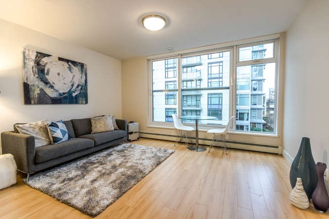 """Brand new, GST PAID, bright, open-concept 1 bed + 1 full-sized flex + 1 parking spot in the heart of Olympic Village. Situated between both Expo-Millenium & Canada Line Stations. Steps to all amenities that Olympic Village has to offer. There's plenty of natural light with 8'4"""" ceilings, north-facing MOUNTAIN VIEW, floor-to-ceiling windows plus Juliet balcony. High-quality design & finishing: spa-style bathroom with Grohe rainfall shower; quartz countertops; Bloomberg integrated fridge & dishwasher; Fulgor Milano stainless steel wall oven & cooktop. 2nd & 8th floor rooftop landscape gardens with communal planters & BBQ lounge, clubhouse with full kitchen facilities, lounge area w/ media, dining area & 2 extended indoor/outdoor patios, 12-hour concierge, etc. Open house March 17-18, 1-4pm."""