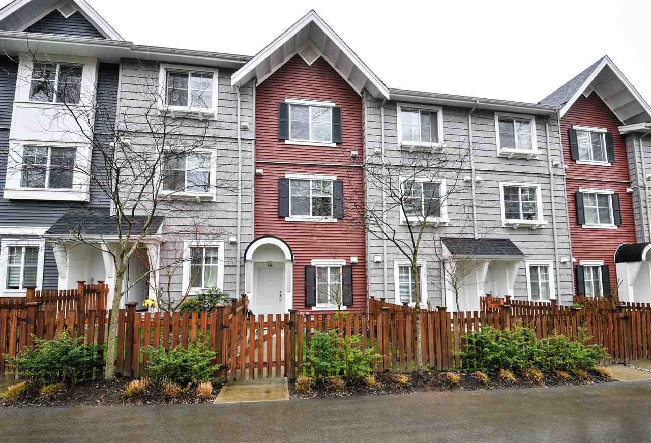 "This beautiful Brookside townhome is located on the permanent greenspace side of the complex. Features 2 good size bedrooms & a 5 pce bath upstairs w/ quartz countertop + a den & a 3 pce bath at the entry level. All 3 levels of this home have durable wood laminate flooring. The main level is an open living space w/ 9? ceilings, extra tall upper cabinets w/ crown in the kitchen, quartz countertops, kitchen island w/ a breakfast bar, porcelain apron sink & SS appliances. Includes 2"" faux blinds, R/I vacuum, AC venting in the living rm and master bed. Outdoor areas include a large balcony off the living rm & a fenced yard w/ a gate out the front door. Walk to neighbourhood parks, shops and restaurants in a new and vibrant community."