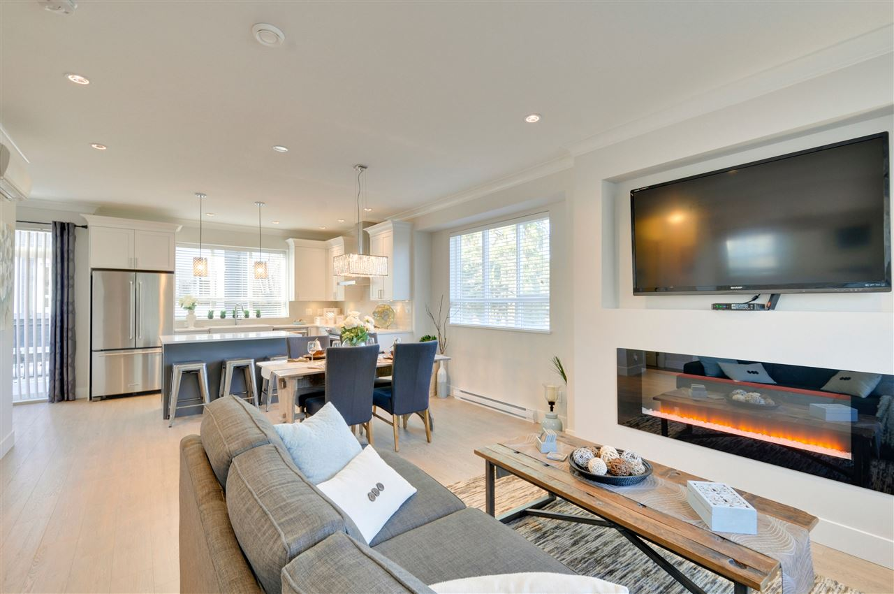 Brookside Walk END UNIT - brand new high-end townhome, completed & ready to move-in w/ 3 beds + den, 3 baths all w/ quartz countertops, double side-by-side garage, extra-large balcony & mini split heat pump w/ AC. Main floor features a gourmet kitchen w/ 3cm quartz countertops, kitchen island, shaker style soft close cabinetry, SS KitchenAid appliances, chimney style hood fan, durable laminate flooring, crown moulding, spacious dining rm & a TV feature wall w/ a Napoleon fireplace in the living rm. Tile floor & base in baths upstairs. Frameless 10mm thick ensuite shower door & tile surround. Automatic lawn & garden irrigation. So many great features. A complex of only 5 homes located on permanent greenspace. No Property Transfer Tax. OPEN HOUSE May 26-27 Sat-Sun 2-4pm