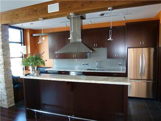 Stunning RENOVATION in this Two Bedroom + Den home with TEN FOOT ceilings! OH MY! You'll appreciate the Gourmet kitchen with top of the line Stainless Steel appliances, granite counters, and open layout. Master bedroom ensuite has a two person steam shower and double sink. The touches include an extensive use of imported tile, fixtures and hardwood flooring. NO pets and rentals are at a maximum. The amenities are first class: Guest Suite, indoor swimming pool, exercise centre, multi-purpose room and walking distance to the Canada Line, VGH Hospital and Cambie Village. THIS IS A TENANTED PROPERTY showings by appointment Thursday and Sunday between 2-3pm.  Pictures are taken prior to the property being tenant occupied.