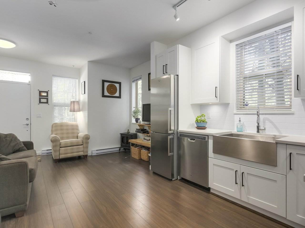 This beautiful, end unit townhome in Maplewood Place, could be yours. Centrally located with shopping, transit, parks, and quick access to HWY 1. Built by Anthem Properties, this 1 bedroom/1 bathroom unit has an efficient layout, 2 patios, in-suite laundry, an apron sink, and stainless steel appliances. As an end unit, you'll enjoy more natural sunlight than your neighbours with windows on three sides. If you love North Vancouver and all it has to offer, you'll love this townhome.