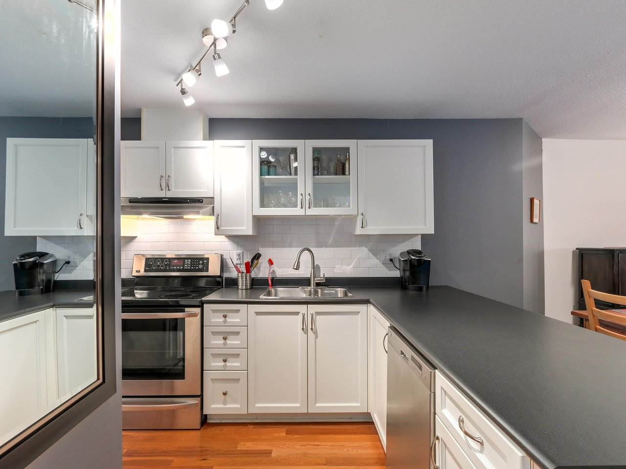 Location, Size, Layout & Quality!  It's all here.  X-Large (814 sq ft), beautifully renovated 1 bed garden suite with 148 sq ft patio in RAINSCREENED building by Douglas Park.  Walk to Granville Island, Kitsilano, Cambie Village, Main St...you are in the heart of it all here!  This gorgeous sizable condo offers a kitchen with expansive counter space, award winning K.Craft cabinetry, st.st. appliances, and a full size pantry.  The open dining area and large living room each look onto a 23' long patio and trees offering privacy on quiet 21st Ave.  Tired of tiny bedrooms....this is a KING sized bedroom with walk in closet and a spacious ensuite offering 2 sinks.  Rentals & 1 cat or dog okay!                Open House Sat. Aug. 18th 2:00-4:00