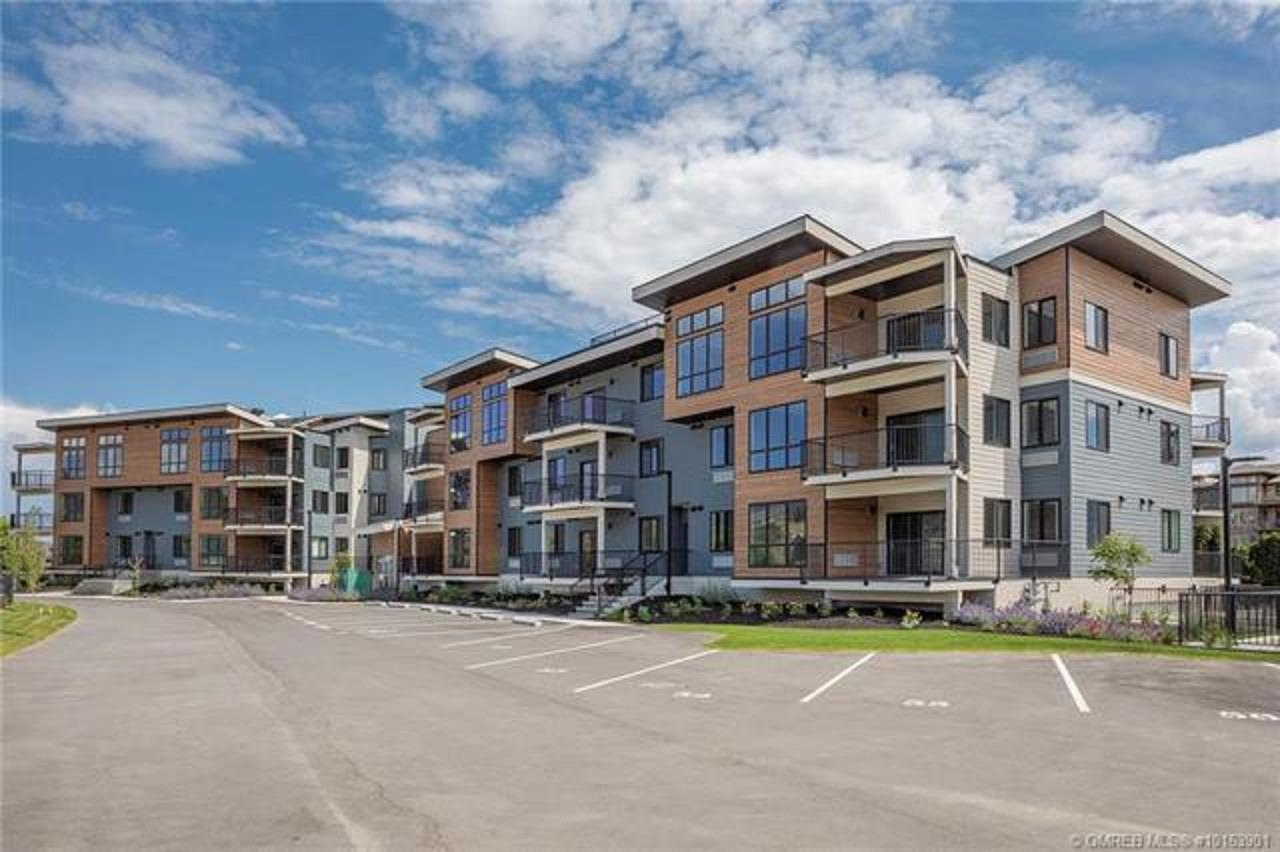 Live and play in West Kelowna! Just a short walk to the beach and located along the West Kelowna wine trail, this brand new condo is just minutes to everything from shopping, dining, wineries and more. Walk to several beaches, play parks, Gellatly nut farm, Bonfire Grill, Spa at the Cove Resort, yacht club, plus hiking and biking trails. Bright and open 2 bedroom, 2 full bathroom condo with vinyl plank flooring, SS whirlpool appliances, quartz counter tops, recessed lighting, 9ft ceilings, neutral pallet and built in closet organizers in every room. The kitchen boasts island with bar seating area plus a pantry to keep your kitchen tidy and organized. The Master suite features walk through closet and a large ensuite bathroom with his/her sinks and a tiled walk in shower. Enjoy the Okanagan evenings year round on the large covered deck. Gellatly Place offers secure underground parking plus available extra parking if needed. This is Luxury Okanagan living!