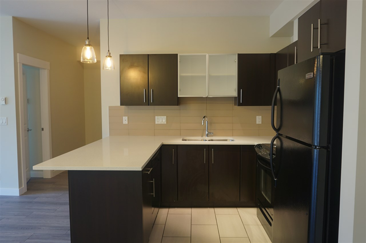 Modern designed Condo in Tempo with 9' ceilings! 2 spacious beds & 2 bath plus Den on 3rd floor unit facing South Courtyard. Features brand new granite counters, all new laminate floor throughout, fireplace and also provide you 1 parking stall and 1 storage. Close to Sevenoaks Shopping mall, Mill Lake Park, University of Fraser Valley, easy access to Hwy #1, Abbotsford Regional Hospital and Cancer Centre and more. Enjoy your living in this lovely home. Please contact for the private viewing.