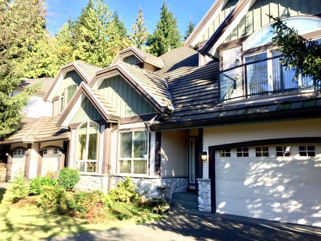 "Here is an exceptional opportunity!This impeccable single-owner home, on sought-after Westwood Plateau, was the original the show home. With many developer upgrades it backs onto a forested greenbelt and hiking trails. Quiet and peaceful, yet close to shopping, schools and transit. The house is positioned on three levels, ideal for a growing family or for entertaining. A spacious foyer on the main floor leads to an open concept living area with gorgeous maple flooring and comprises a kitchen, an abundance of cabinets, updated quartz island, spacious dining room, a family room overlooking the sunken sitting room and enlarged balcony, with a spectacular view of Mount Baker and the Fraser Valley. Upstairs there are three bedrooms, the Master ""Room with a View"" features a glass covered deck, a double-sided gas fireplace and spacious bathroom. The lower level opens directly onto a large private garden with a large bedroom, ample space for family and guests or possibly turned into a suite with City permits!"