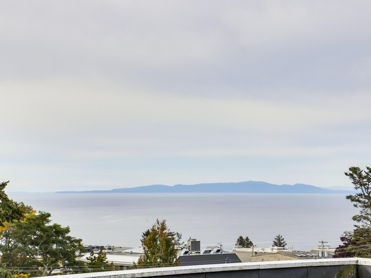 This charming top floor ocean view condo features a huge balcony to take in all of the sunsets and action at the highly sought after Five Corners location. Steps to schools, transit, shopping. restaurants, churches and a 10 minute walk to the beach. One bedroom and large den with big closets in both rooms. Lots of storage with huge pantry and in-suite laundry. Well managed peaceful and quiet building with roof top patio and rec room. Bring your ideas for upgrading as this is a great opportunity to own in sunny White Rock. There are no rentals, no pets, no Age restrictions and one secured parking stall. Call your Realtor to set up a private showing.