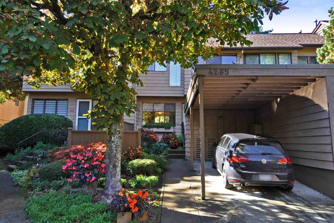 Original owner! Renovated and in EXCELLENT condition! HUGE deck in the backyard! 2018 ensuite bathroom. 2018 hot water heater. 2006 furnace that is annually serviced. 2007 powder room with Toto pedestal sink & toilet. Hardwood floors on the main refinished in 2018. Deck refinished in 2018. Updated kitchen with Corian counter-tops, new cupboards, attractive tile back-splash and ?extra? built-in cabinets. S/S kitchen appliances. Dining room built in drawers/cupboards, mirror. Newer marble fireplace surround with a wooden mantle. Newer light fixtures throughout. Glass blocks beside front door for added natural light. Master bedroom closet organizer. Basement is very nicely finished. A very well cared for townhouse! Single covered carport.