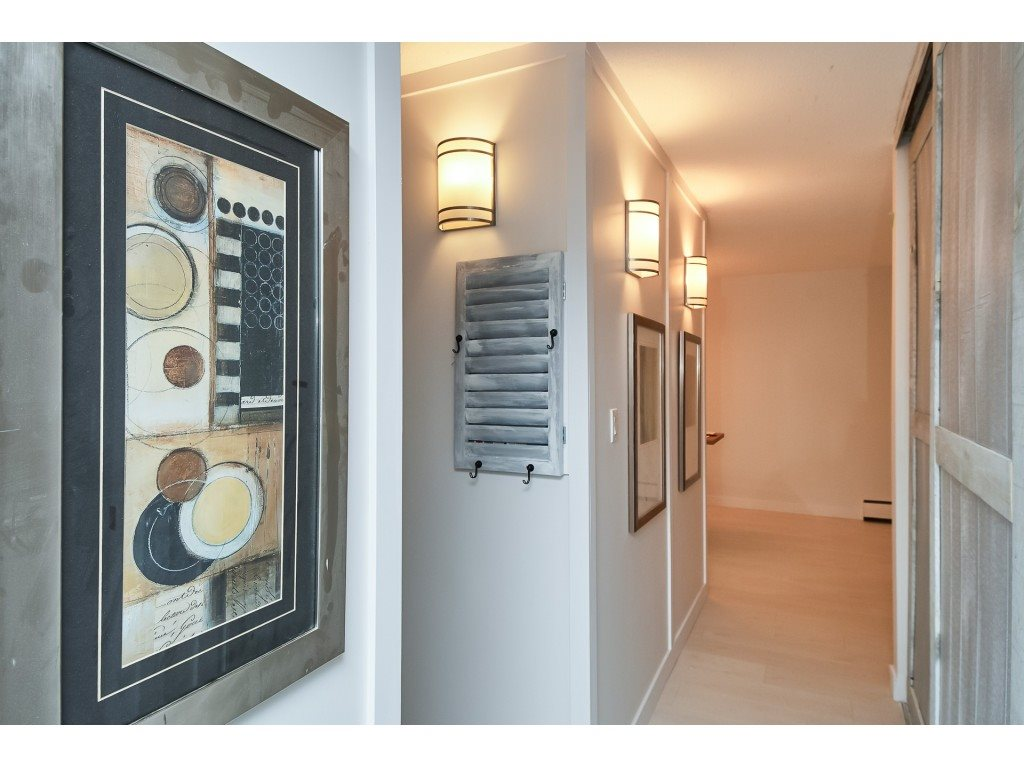 SHOWS LIKE A 10! FULLY RENOVATED Cozy and Quiet White Rock Condo! MOVE IN READY. Features beautifully renovated Kitchen and Bathroom complete with designer finishes and a stunning modern look. This condo is a one of a kind. Designer Swedish Bianco engineered laminate flooring that runs seamlessly throughout the condo is a very light grey wood grain offering a very beachy and clean feel. High Quality Paint throughout light grey fresh and clean, 4? baseboards throughout. Brand New appliances, portable island, and huge pantry. Good size enclosed balcony with sliding glass doors. No rentals, 1 cat allowed. INSUITE LAUNDRY JUST APPROVED FOR ANOTHER UNIT IN BUILDING & CAN BE NEGOTIATED INTO PRICE.