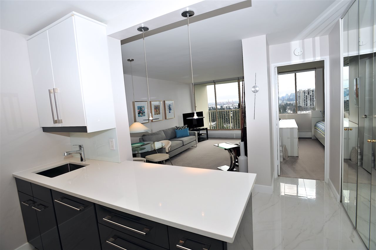 HIGH END RENOVATIONS WITH OUTSTANDING CITY SKYLINE AND WATER VIEWS. This seldom avail '02' one bdrm suite in Woodcroft's popular Whytecliff building fronts the Capilano River and offers panoramic views of Vancouver Island, Lions Gate Bridge, Stanley Park and downtown. High end renovations with a modern open floor design sets this suite apart. Modern kitchen soft closing cabinets, quartz countertops, Grohe sink faucet, and stainless steel appliances. Beautiful tile flooring in kitchen, hall and bathroom. Quality carpets in living room and bdrm. Luxurious bathroom with modern cabinets, full tiled walk-in shower with frameless glass door, and  high end Hansgrohe shower unit, faucets and accessories. Designer lighting throughout. Building has many infrastructure upgrades including new hot and cold water plumbing, new roof, new elevators, exterior concrete repairs, great amenities, indoor pool, sauna, jacuzzi and gym. On site manager and 24/7 manned security. One parking stall and storage locker.