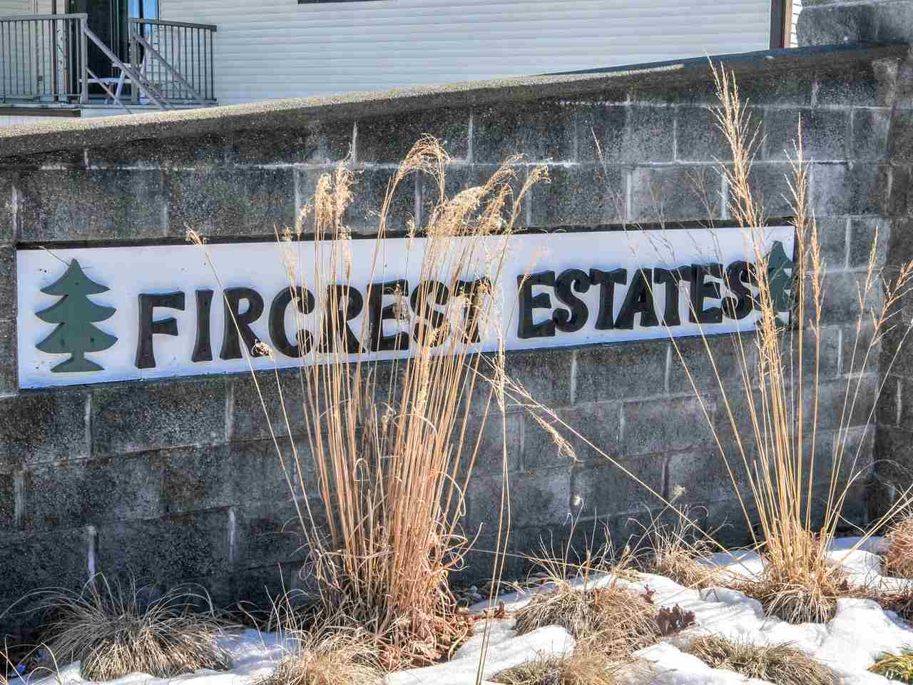 Exceptionally well maintained upper , corner unit in sought after Fir Crest Estates! Sunny & bright location w/ 230 sqft of large covered decks, one for the BBQ & one solarium. Updates include laminate flooring, new Kenmore fridge, water filter system and Kenmore stacking washer/dryer. Spacious master bedroom has a nice size walk in closet & the den has been converted to a 2nd bedroom with built in Murphy bed and cabinets. Well run highly sought after 55+ complex with reasonable strata fee, incl. heat, water, hydro & gardening. Clubhouse w/full kitchen can be reserved for parties, games room, library, workshop & car wash area. Covered carport & visitor parking, RV parking option($), convenient location to shopping and transit.