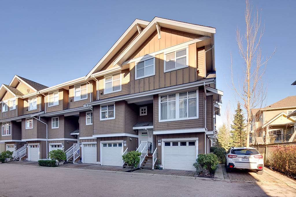 Bright, spacious 3 bdrm 3 bath PLUS ground flr recreation rm (a 4th bedroom)   corner unit T/H on a very popular, good, quiet, family oriented neighbourhood in NW. High ceilings, gas fireplace,Powder room on main floor, bright dining room, granite counter top in kitchen w/new fridge, new washer/dryer & kitchen cabinets, new stove and new laminate floorings on 3 upstairs rooms and ground floor Recreation room. Balcony on main floor. Fenced backyard w/ patio.Parking spot beside this corner unit. Walk to bus stop, schools, shopping, & restaurants. Very near giant outlet stores, Walmart, new community centre, new water park, and library. Easy hwy access to Rmd, Surrey,Vancouver. Lots of visitor?s parking. Low strata fee! Everything you need is right here!!!