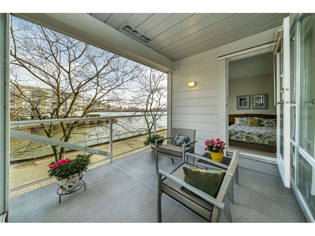 WATERFRONT! This 2 bed 2 bath condo is a nature lover's dream! Enjoy walks along river walk or relax on your large covered patio watching wildlife & tugboats on the Fraser River. This beautiful home features stainless appliances, faucets in the kitchen and bathrooms, newer lighting. Bright open floor plan with large view windows, there is good sized in-suite storage room & a cozy gas fireplace. Well maintained FREEHOLD building (rain screened, new plumbing, roof, exterior paint) Access to clubhouse featuring TV, kitchen, pool table, party room, a well equipped exercise facility and hot tub with a view. Located near shopping, this hidden jewel offers an easy commute to downtown Vancouver, YVR, UBC, Metrotown & more! Pets welcome
