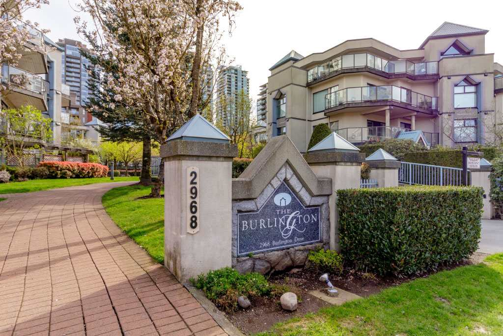 Amazingly quiet peaceful location, yet just steps to SkyTrain, Coquitlam Centre, Glen Pine Community Centre & all amenities. Gorgeous sunny 2 bedroom & den corner suite overlooking lovely courtyard & gardens. Professional, tasteful, high end renovation throughout, along with 2 parking spaces & storage locker makes for a unique buyer opportunity. Beautiful, open designer island kitchen where both the chef & wine sippers will be happy - top quality Cambria counters, cappuccino cabinets, travertine backsplash & stainless-steel appliances.  Maple hardwood flooring & a wall of invisibly tinted windows frames a glorious garden view & large covered deck. Separate spacious den as well as 2 generous bedrooms. Ensuite has bathtub & shower with custom glass door & a ?Dovedale? Cambria quartz vanity.  Brand new stacking washer & dryer. Fully rain screened, well maintained building in this oasis amidst urban living.